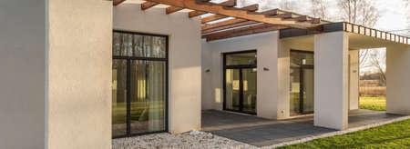 big windows: Panorama of modern design concrete house with big windows