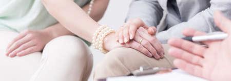 marital: Close up of pair overcoming marital crisis during therapy