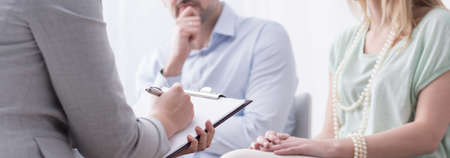 Panorama of psychologist helping married couple with problem
