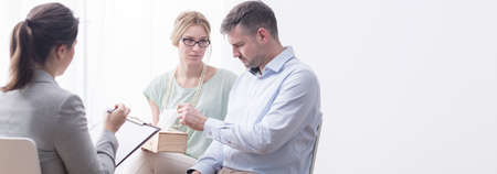 marital: Panorama of psychologist and people during marital therapy,