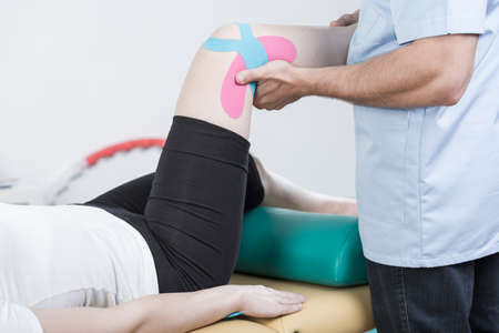 human knee: Sporty woman undergoing rehabilitation of sprained knee Stock Photo