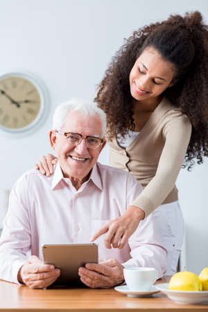family support: Picture of happy old man having family support
