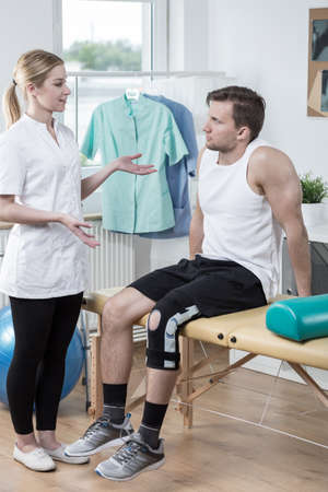 stabilize: Physiotherapist discussing medical treatment with her patient