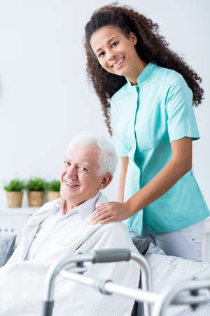 Image of old male and medical private home care Stock Photo