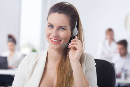 telemarketer: Image of happy pregnant telemarketer during work