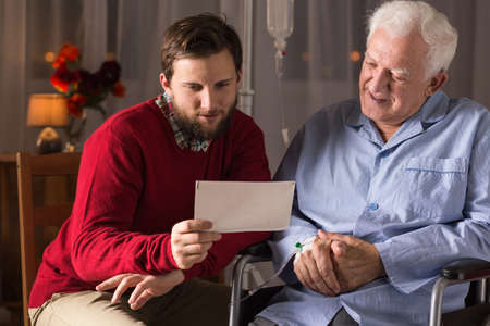 nearness: Son visiting ill father in rest home Stock Photo