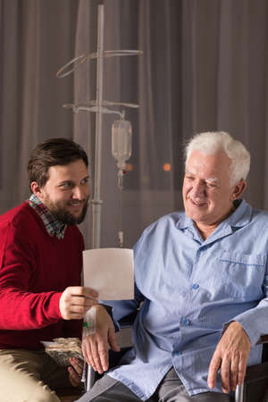 nearness: Son visiting disabled father in nursing home