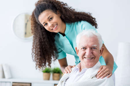 Image of elderly man having private home care Stock Photo