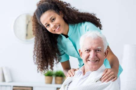 Image of elderly man having private home care Foto de archivo