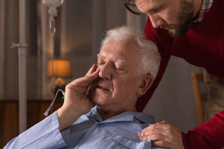 nearness: Photo of son caring about dying father