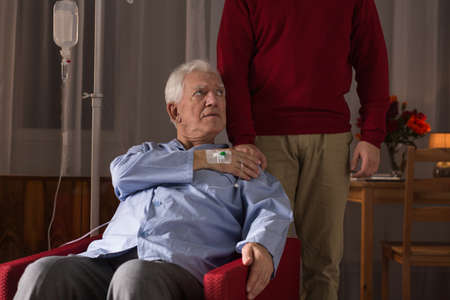 incurable: Terminally ill man and his caregiver at home