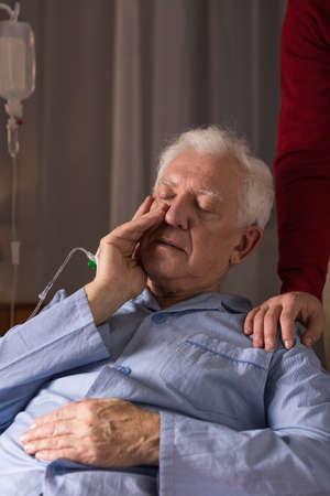 nearness: Image of senior man suffering from serious illness