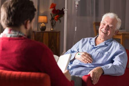 senile: Carer assisting senior man with senile dementia Stock Photo