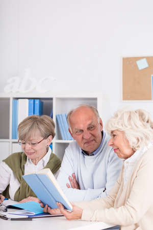 elderly people: Elderly students are studying together in classroom