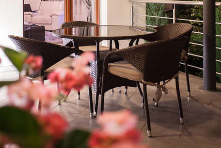 home and garden: Modern and elegant wicker furniture on the terrace