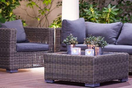 Elegant stylish garden furniture in the arbour 스톡 콘텐츠