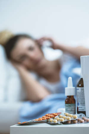 nightstand: Medicines for cold lying on the nightstand