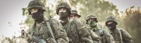 proving: Military soldier in uniform on training field Stock Photo