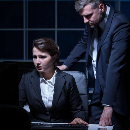 light duty: Woman and man have hard night in office