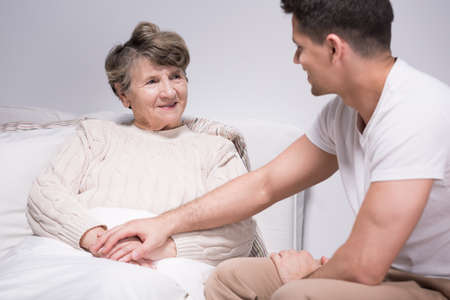 boy lady: Young helpful grandson spending time with grandmother