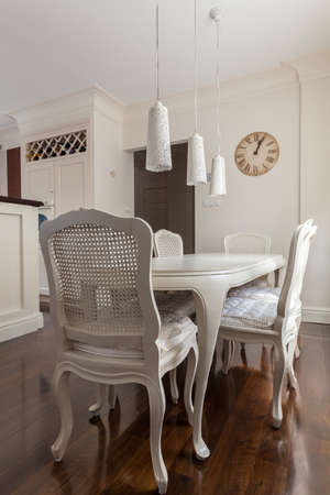 dining room: Decorative chairs and table in the kitchen