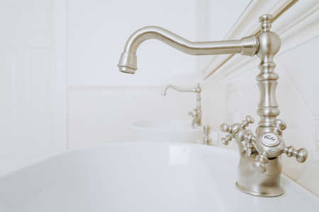 roomy: Decorative faucets in white and stylish bathroom Stock Photo
