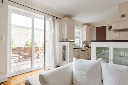 kitchenette: Living room with a view on a terrace