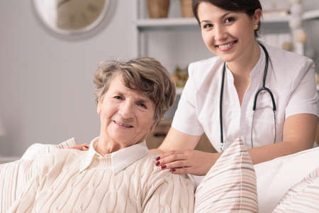 senility: Young pretty nurse and her nice senior patient Stock Photo
