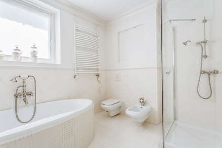 White and stylish bathroom in the house Stock Photo