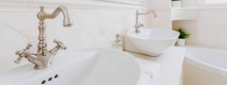 roomy: White and porcelain washbasins in the bathroom Stock Photo