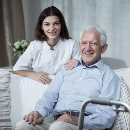 caring nurse: Disabled senior man and beauty caring nurse