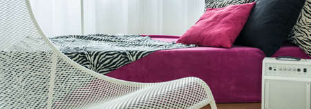 rosa negra: Modern white chair and bed with pink,black and zebra pattern bedding