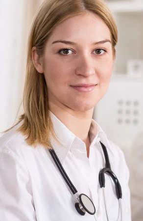 private hospital: Portrait of young female doctor with stethoscope
