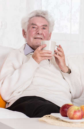 gray haired: Senior man with a cup of coffee Stock Photo