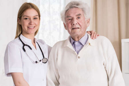 ageing: Female doctor and her patient posing for a photo