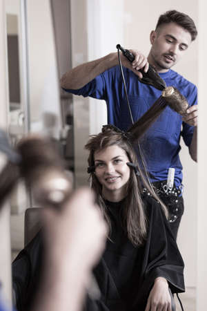 Woman visiting a hair stylist and getting a new hairdo