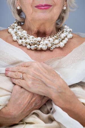 elderly woman: Elderly woman with elegant dress and stylish, pearl jewellery