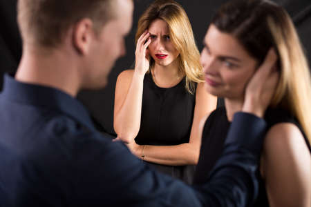 tempt: Picture of betrayed wife and unfaithful husband with lover
