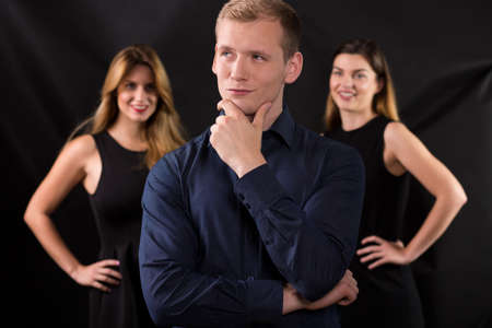 cheat: Image of confident macho and attractive women Stock Photo