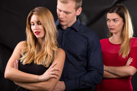 emotional love: Photo of man with mistress and his betrayed wife