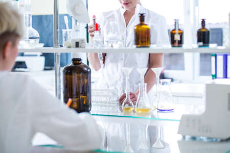 well equipped: Two scientists during work in well equipped laboratory.
