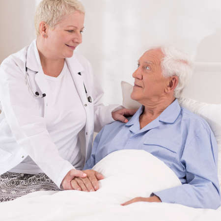 senescence: Photo of elderly patient having professional care at hospital Stock Photo