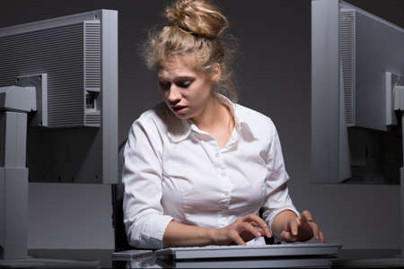 psychical: Young woman is hurrying up at the work Stock Photo