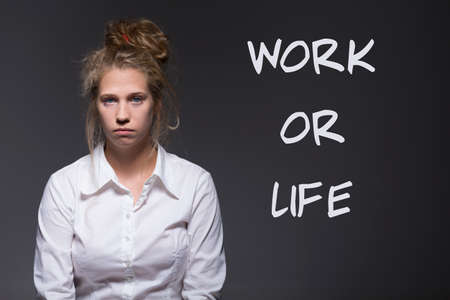 embarassment: Because of work young woman does not have time Stock Photo