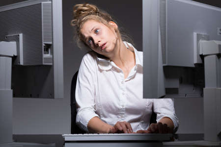 after hours: Young woman has lots of work after hours