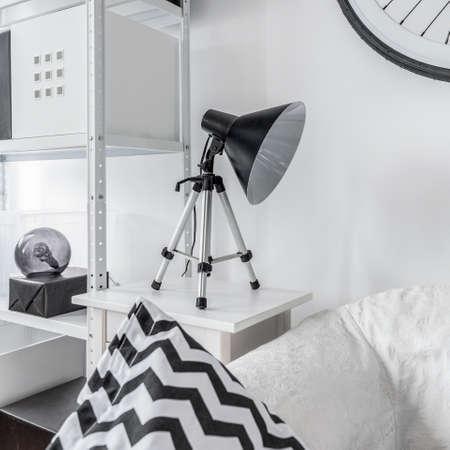 nightstand: Close up of stylish night lamp standing on nightstand