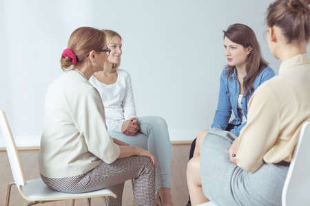 People discussing something during support group meeting
