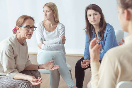 Young woman is talking about her problems Stock Photo