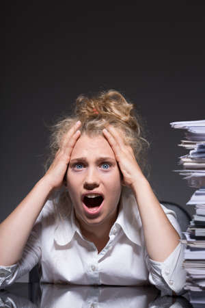 Woman has to do paperwork after hours