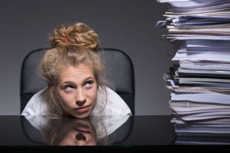 Young woman is stressed about her paperwork
